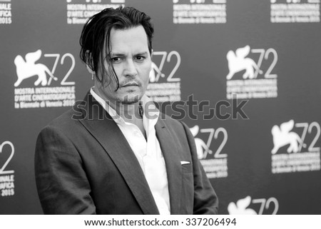 VENICE, ITALY - SEPTEMBER 4: Johnny Depp poses during the photo-call of 'Black Mass' during the 72nd Venice Film Festival on September 4, 2015 at Venice