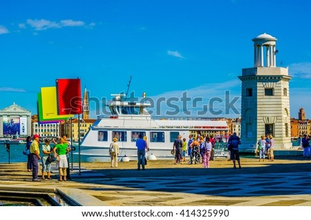 VENICE, ITALY, SEPTEMBER 20, 2015: People are strolling in front of the Church of San Giorgio Maggiore on the island. One of the main attractions of Venice. - stock photo