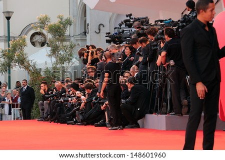 VENICE, ITALY - SEPTEMBER 07:Photographers during a red carpet at the Venice Film Festival on September 07, 2012 in Venice, Italy  - stock photo