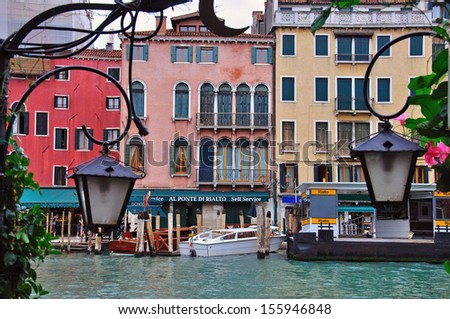 VENICE, ITALY - SEPTEMBER 29: The station of gondolas before the day begins on September 29, 2012. Venice is the most popular city in Veneto region.