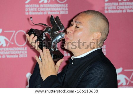 VENICE, ITALY - SEPTEMBER 07: Tsai Ming-liang poses with the Grand Jury Prize he received for his movie 'Jiaoyou' during the 70th Venice Film Festival on September 07, 2013 in Venice, Italy  - stock photo