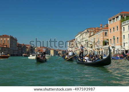 Venice, Italy - 8 September, 2016: Venetian gondoliers punting gondola through waters of Venice Italy