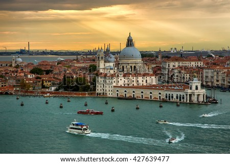VENICE, ITALY - SEPTEMBER 24, 2015: View from San Giorgio Maggiore belltower at the Santa Maria della Salute church on a sunset