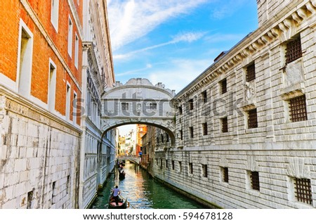 Venice, Italy - September 3, 2016 : View of the Bridge of Sighs with Gondolas punted by gondoliers on the canal in Venice on September 3, 2016.