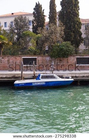VENICE, ITALY - 15TH MARCH 2015: A local police boat in Venice along the canal.