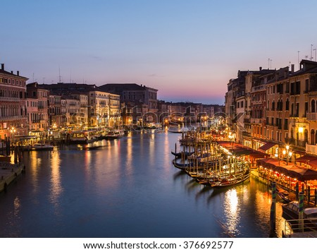 VENICE, ITALY - 14TH MARCH 2015: Venice Cityscape from Rialto Bridge showing buildings and restaurants.