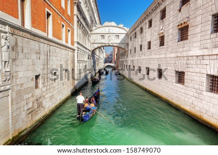 Venice, Italy. The Bridge of Sighs, gondola floats on a canal among old Venetian architecture - stock photo