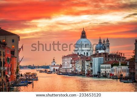 Venice, Italy. View over Canal Grande to basilica of Santa Maria della Salute on sunrise. - stock photo