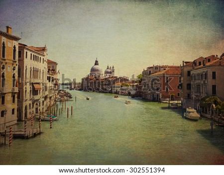 Venice, Italy - Vintage view of Grand Canal and  Saint Mary of Health church. Grunge and retro filter added. - stock photo