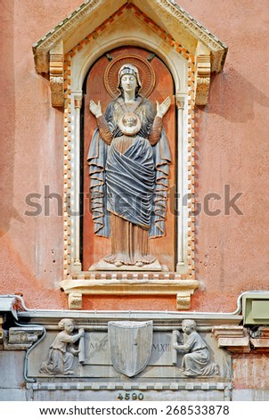 Venice, Italy, woman and child statue in Cannaregio area. - stock photo