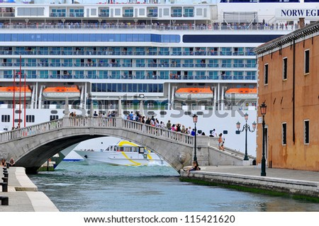 VENICE - JUNE 12: Cruise ship crossing Grand canal on June 12, 2011 in Venice, Italy. More than 20 million tourists come to Venice annually. - stock photo