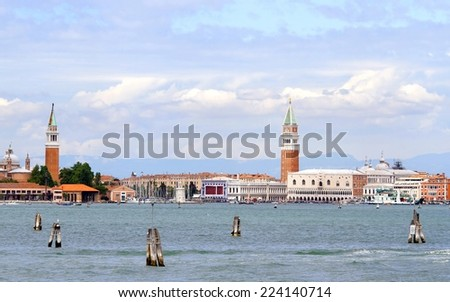 venice lagoon with bell tower of St. Mark and St. George and Adriatic sea - stock photo