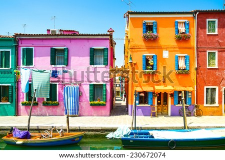 Venice landmark, Burano island canal, colorful houses and boat, Italy, Europe. - stock photo