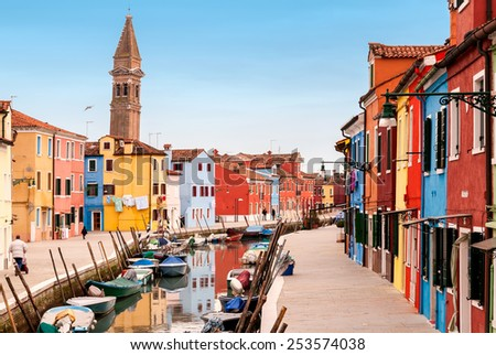 Venice landmark, Burano island canal, colorful houses and boats, Italy.  - stock photo
