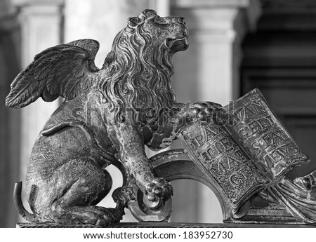 Venice - Lion bronze statue as symbol of st. Mark the Evangelist - patron of the town from gate of bell tower.