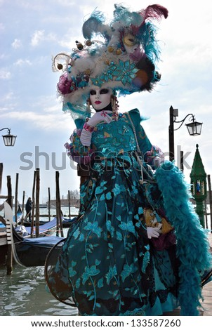 VENICE - MARCH 7: A participant in St. Mark's Square during the Carnival of Venice on March 7, 2011. The 2011 carnival is held from February 26th to March 8th. - stock photo