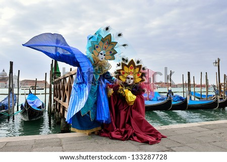 VENICE - MARCH 7: A participants in St. Mark's Square during the Carnival of Venice on March 7, 2011. The 2011 carnival is held from February 26th to March 8th. - stock photo
