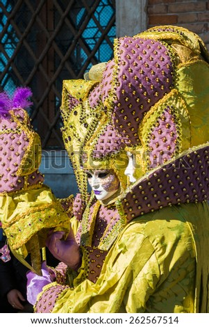 VENICE - March 15, 2015: People in Venetian costume attend the Carnival of Venice, festival starting two weeks before Ash Wednesday  in Venice, Italy.: - stock photo