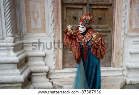 VENICE - MARCH 5: Person in Venetian costume attends the Carnival of Venice, annual festival starting two weeks before Ash Wednesday and ends on Shrove Tuesday, on March 5, 2011 in Venice, Italy.