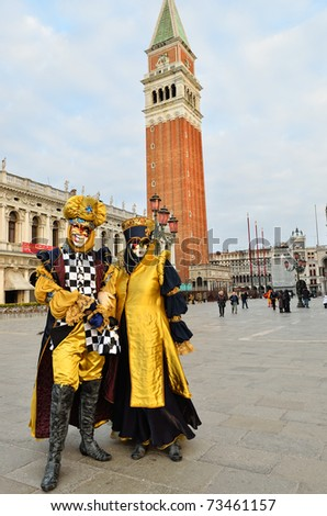 VENICE - MARCH 7: Two unidentified masked persons in costume in St. Mark's Square during the Carnival of Venice on March 7, 2011. The 2011 carnival was held from February 26th to March 8th. - stock photo