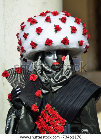 VENICE - MARCH 7:  unidentified masked person in costume in St. Mark's Square during the Carnival of Venice on March 7, 2011. The 2011 carnival was held from February 26th to March 8th. - stock photo
