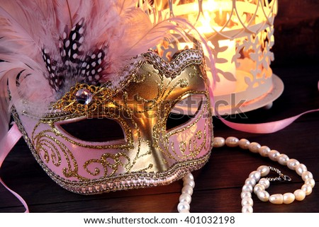 Venice mask and candlestick - stock photo