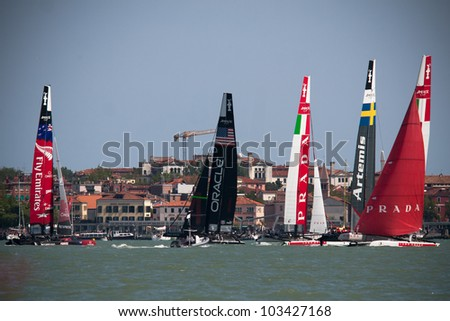 VENICE - MAY 18 - Fleet race of America's cup series in front of Lido's island on May 18, 2012 Venice. - stock photo