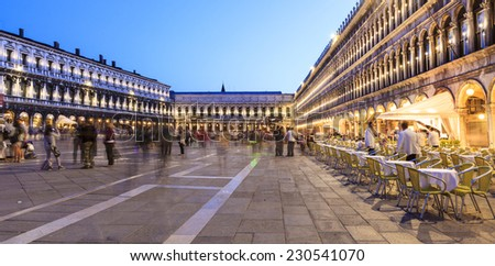 VENICE - MAY 17: St Mark's Square at night on May 17, 2014 in Venice, Italy. The Piazza is the central landmark and gathering place for Venice.  - stock photo