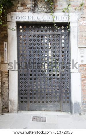 Venice metal door with ornaments - stock photo