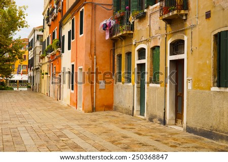 VENICE - SEP 12: Venice street on September 12, 2014 in Venice, Italy. Venice is a city in northeastern Italy sited on a group of 118 small islands separated by canals and linked by bridges