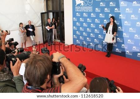 VENICE - SEPTEMBER 8: Alex Schmidt poses for photographers at 69th Venice Film Festival on September 8, 2012 in Venice, Italy. - stock photo