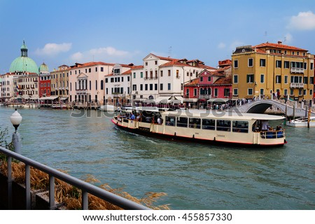 Venice. The Grand canal. The Grand canal is Venice's most famous canal, which runs through the city. Most of this traffic - water buses, gondolas or boats, it runs along the Grand canal. - stock photo