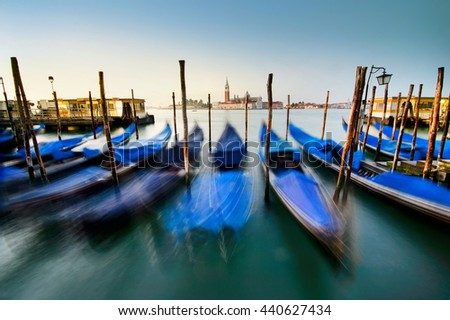 Venice with famous gondolas at sunrise, near San Marco square, Italy - stock photo