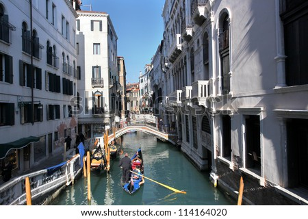 Venice with gondola on canal in Italy - stock photo