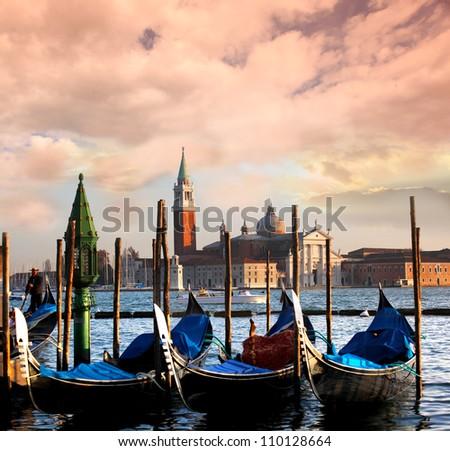 Venice with gondolas on Grand Canal against San Giorgio Maggiore church - stock photo