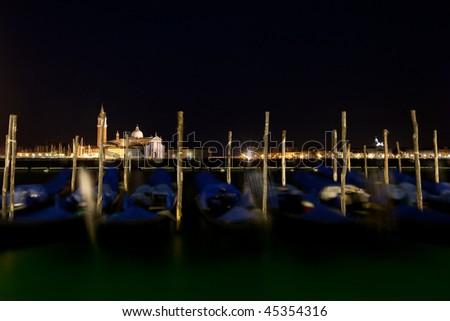 Venice with its gondola boats by night - stock photo