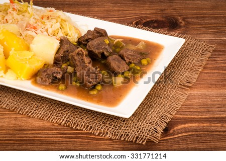 Venison Goulash with potatoes on the white plate.