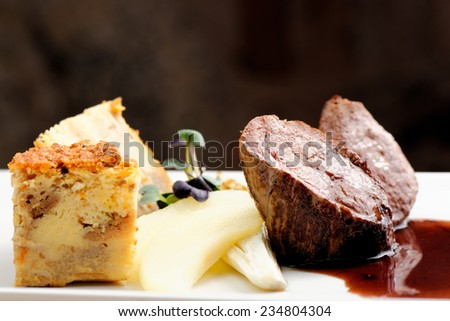 Venison meat steak with egg pie, herbs and Potato  - stock photo