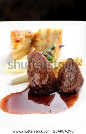 Venison meat steak with Quiche pie, Port sauce, herbs and Potato - stock photo