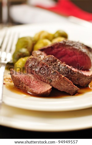 Venison with rose sauce ans vegetables