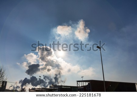 vent an industrial plant with smoke. symbol photo for environmental protection and ozone. - stock photo