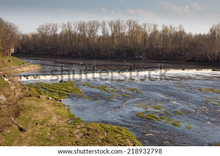 Venta Rapid is a rapid on the Venta River in Kuldiga, Latvia. It is the widest rapid in Europe  249 metres - stock photo