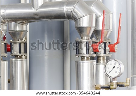 Ventilation and Heating System Valves with baromter - stock photo
