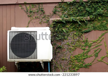 Ventilation of air condition on ivy wall