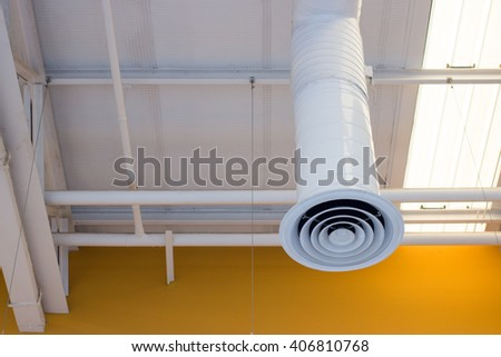 Ventilation opening of an air conditioning system in supermarket. - stock photo