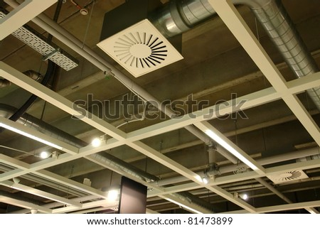Ventilation system pipes on the ceiling of a modern factory plant building
