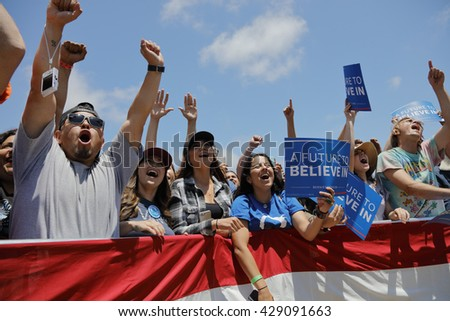 VENTURA, CA - MAY 26, 2016: Supporters of Senator Bernie Sanders hold signs at Presidential campaign rally at Ventura College, in preparation for June 7 California Primary Election.