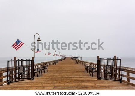 VENTURA, CA/USA - AUGUST 8:  Built in 1872, Ventura Pier attracts tourists and is a local haven for fishing, picnics and views of the Pacific Ocean. VENTURA, CA/USA  AUGUST 8, 2010. - stock photo