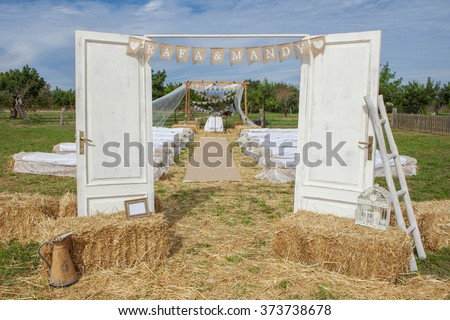 venue decorated for wedding ceremony outdoors ALL THE DECORATIONS, FLAGS, BOUQUET, POSTERS ETC WERE MADE BY ME.   - stock photo