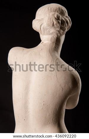 Venus statue on a black background - stock photo